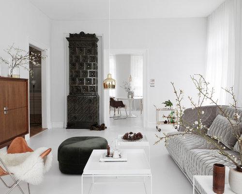 Großes, Fernseherloses, Abgetrenntes, Repräsentatives Modernes Wohnzimmer  Mit Weißer Wandfarbe, Betonboden, Kaminofen