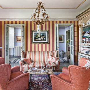 Idee per un soggiorno tradizionale chiuso con libreria e pareti multicolore