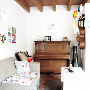 Danish enclosed terra-cotta tile family room photo in Berlin with a music area, white walls, no fireplace and no tv