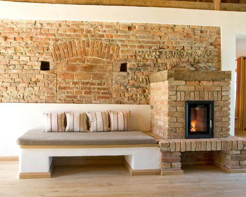Landhausstil wohnzimmer mit kaminsims aus backstein ideen design bilder houzz - Wandfarbe kamin ...