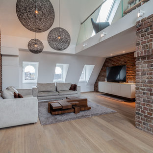 Inspiration for a medium sized contemporary formal mezzanine living room in Cologne with brown walls, a freestanding tv, white floors and painted wood flooring.