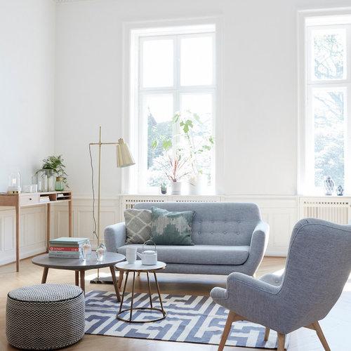 Salon avec un sol en bois clair Dresde : Photos et idées déco de salons