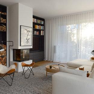 Mittelgroße, Abgetrennte Moderne Bibliothek mit weißer Wandfarbe, braunem Holzboden, Kamin, verputzter Kaminumrandung, Wand-TV und braunem Boden in München