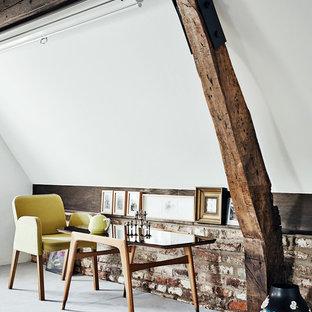 Ejemplo de sala de estar contemporánea, pequeña, con paredes blancas y moqueta