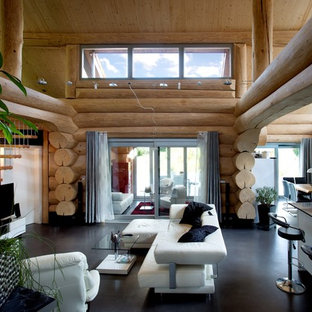 This is an example of an expansive rustic formal mezzanine living room in Other with brown walls, lino flooring, a freestanding tv and black floors.