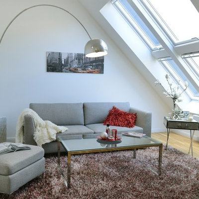 Inspiration for a small scandinavian enclosed light wood floor family room remodel in Berlin with white walls and no fireplace