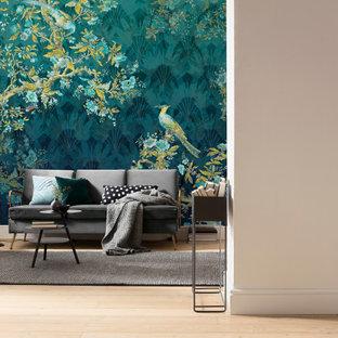 ミュンヘンの大きいトラディショナルスタイルのおしゃれなオープンリビング (青い壁、ラミネートの床、茶色い床) の写真