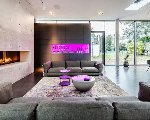 Wohnzimmer mit kaminsims aus stein und betonboden ideen - Wohnzimmer dortmund ...