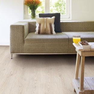 Foto di un soggiorno minimalista con pavimento in vinile e pavimento beige