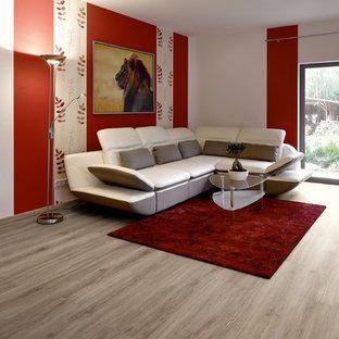 Immagine di un soggiorno classico con pavimento in vinile