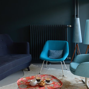 Photo of a mid-sized midcentury open concept living room in Berlin with blue walls, linoleum floors, white floor, no fireplace and no tv.
