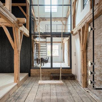 Scheune mit moderner Glasfassade