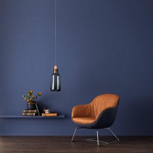 ハンブルクのコンテンポラリースタイルのおしゃれなファミリールーム (青い壁) の写真