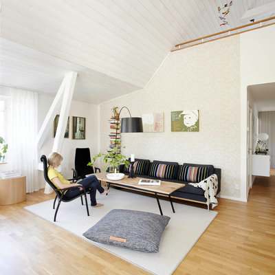 Inspiration for a large scandinavian light wood floor family room remodel in Bremen with beige walls, no fireplace and no tv