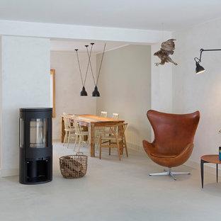 Ispirazione per un ampio soggiorno scandinavo aperto con sala formale, pareti bianche, stufa a legna e pavimento bianco