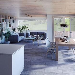 Idee per un soggiorno contemporaneo di medie dimensioni e aperto con pareti bianche e pavimento in ardesia