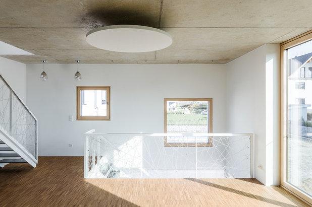 Minimalistisch Wohnbereich by büro für bauform