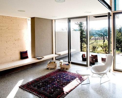 mittelgroes abgetrenntes fernseherloses modernes wohnzimmer mit brauner wandfarbe in bremen - Moderne Wohnzimmer Ideen