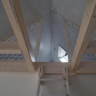 Inspiration för ett litet skandinaviskt allrum med öppen planlösning, med ett bibliotek, vita väggar, linoleumgolv och grått golv