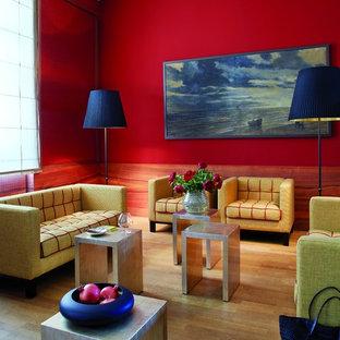 Immagine di un grande soggiorno design chiuso con sala formale, pareti rosse e nessun camino