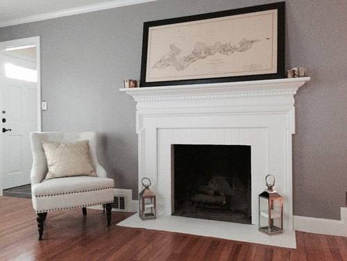 Trying to decide what to do around the fireplace and the floor that I have temporarily painted white to match the mantel. White subway tile? White/grey Carrara marble? Both? Marble on floor and tile around fireplace?