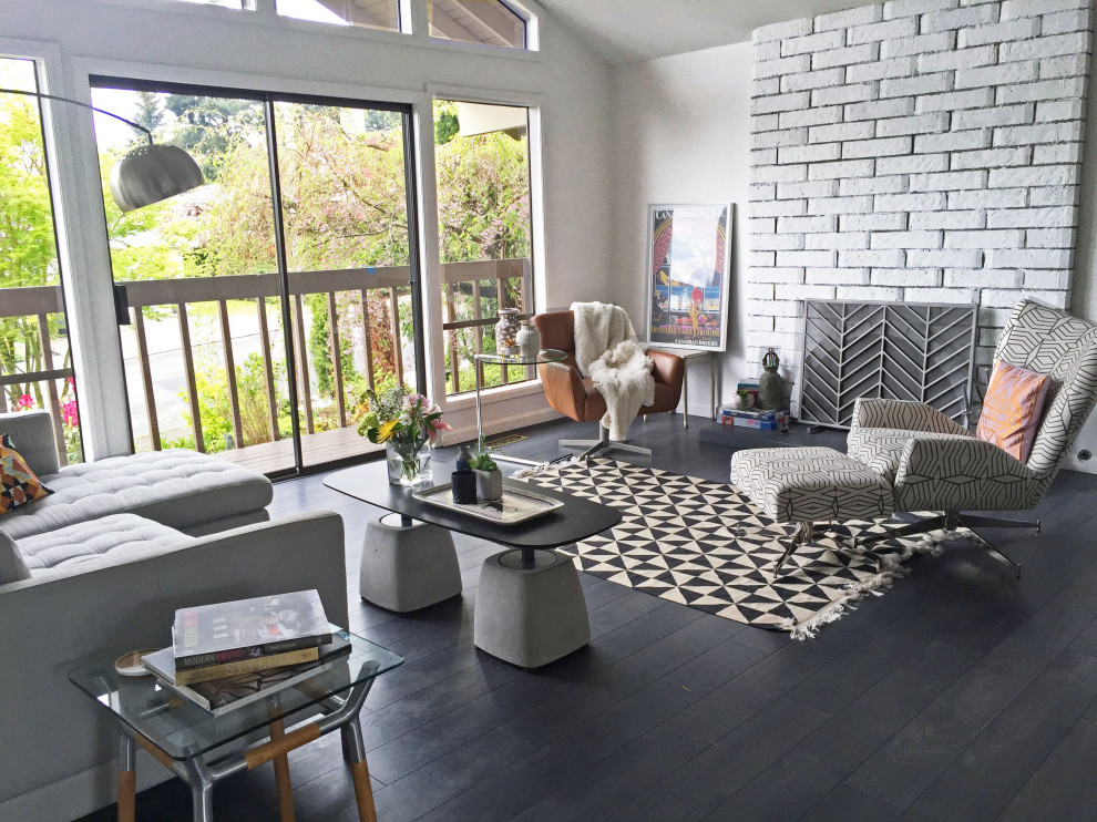 Inspiration for a mid-sized contemporary open concept dark wood floor and black floor living room remodel with white walls, a wood stove, a brick fireplace and no tv