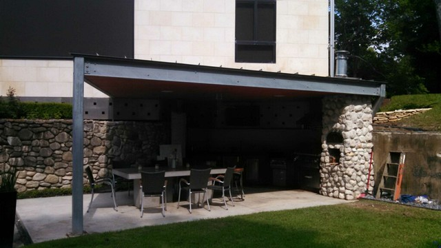 ultra modern houston outdoor kitchen with metal roof - modern