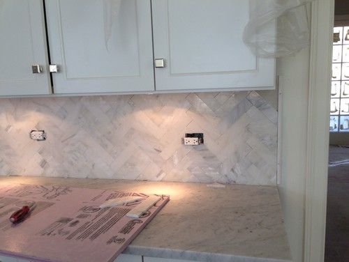 Herringbone backsplash, mitered island