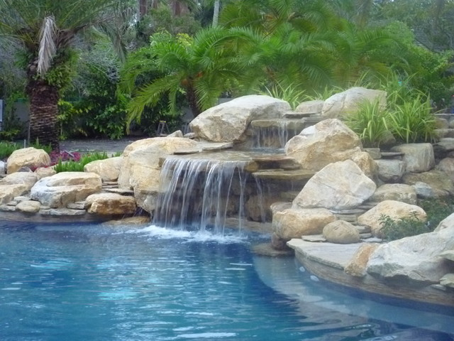 Delightful Pool Waterfall And Rock Garden In South Florida Traditional