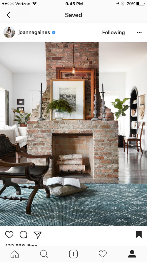 what to do with large two sided fireplace in middle of family room