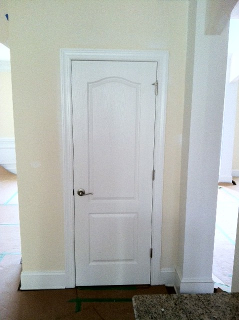 "Please help. Interior doors - not liking the eyebrow arch. Is it ""dated"" or just me?"
