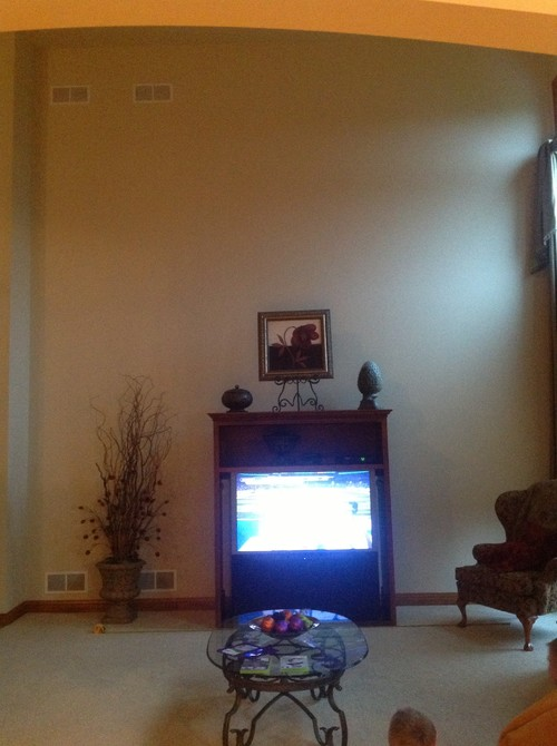 instead consider hanging tv ideas in the photo we have projection tv cabinet on the wall thatu0027s going away also painting and open to ideas