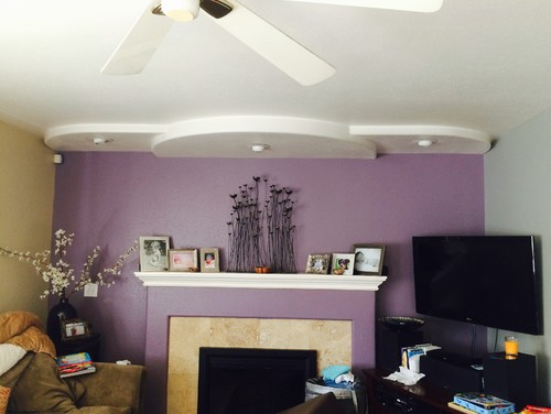 What color s should i do over my fireplace Purple accent wall in living room