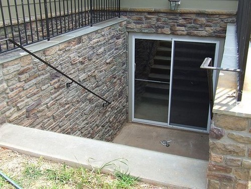 Keeping debris out of drain to exterior basement access for Walkout basement door options