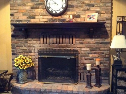 Dark, outdated brick fireplace