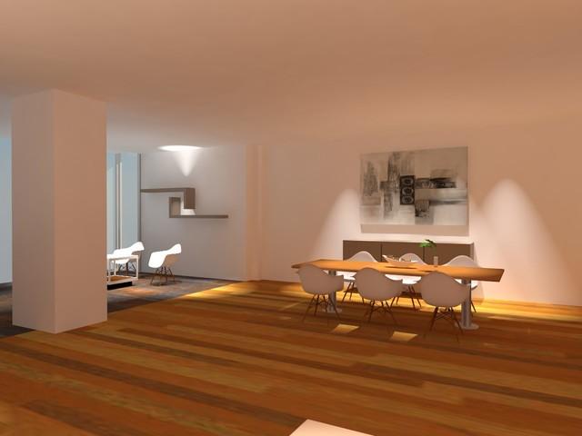 Imagen de comedor grande, abierto, con paredes blancas y suelo de madera en tonos medios