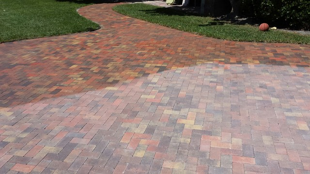 Concrete Cobble Street : In progress brick paver driveway being sealed with