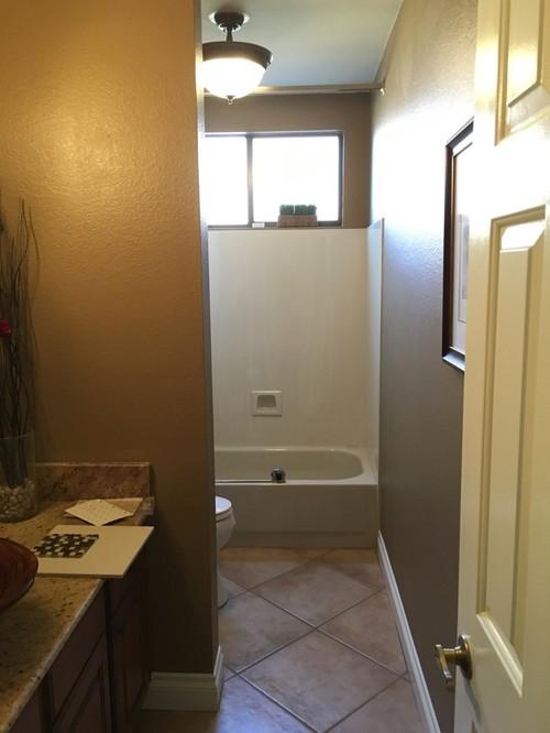 Bathtub/shower door versus splash guard?