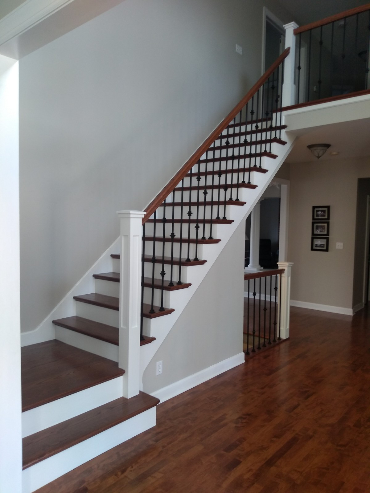 White newels with oak rails and iron balusters