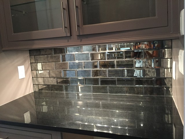 Absolute Black Countertop And 3x6 Mirrored Gray Subway Tile