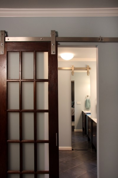 There are various sliding doors that are external to the wall (not pocket  doors) and there are various different types of hardware. A photo by Sharon  .