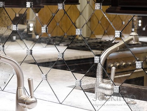 can a mirrored backsplash with stand the heat from the stove top?