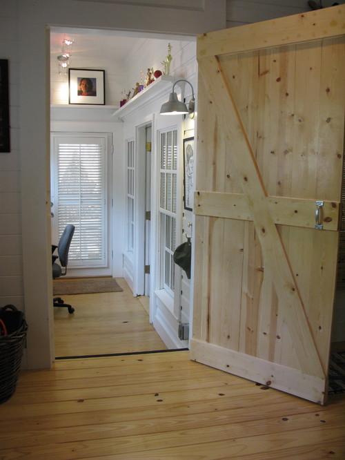 barn door opened to room with barn light