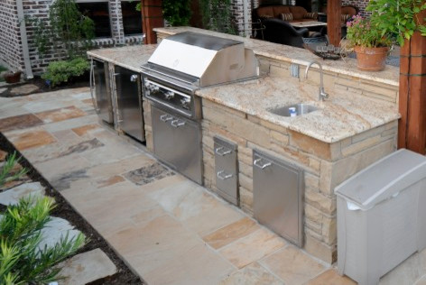 Our outdoor kitchens can include grill warmer for Outdoor kitchen with sink and fridge