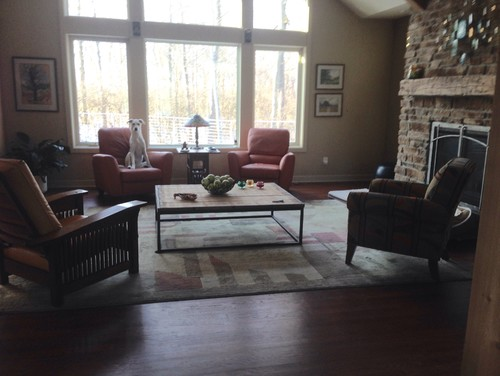 H wants to add a love seat. I am concerned about a cluttered look, and am  unsure about placement. Should we add more chairs, a love seat, or let it  be? - Help Our Naked 4-chair Living Room
