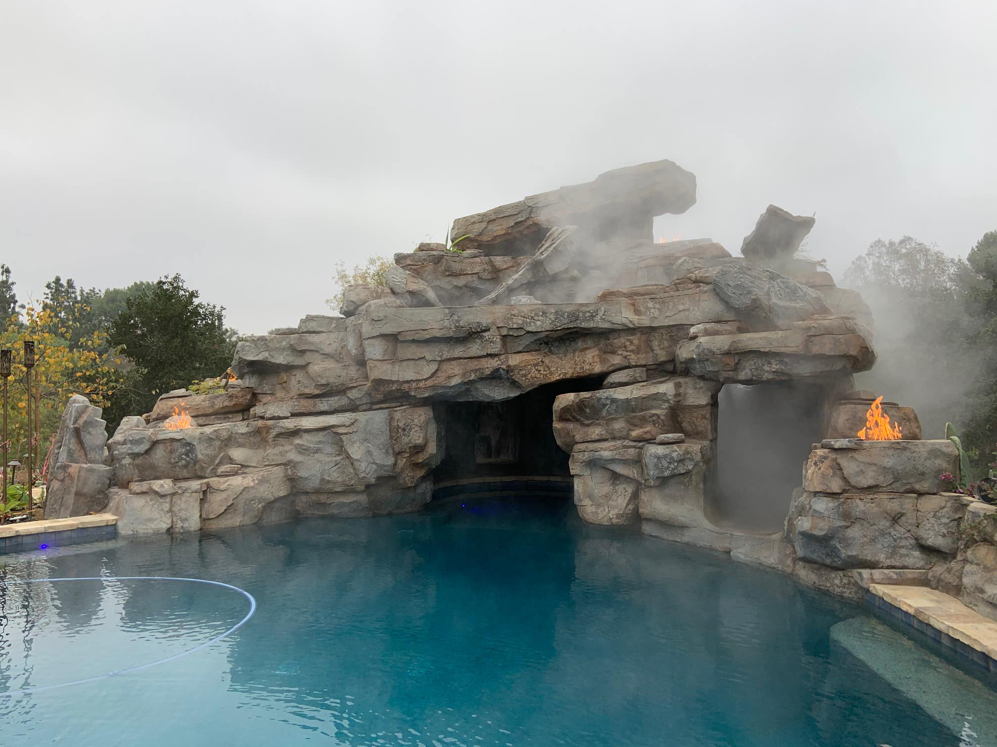 Slide/waterfall/cave with smoke/fire