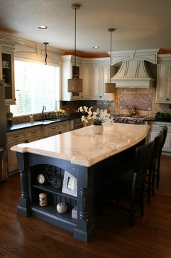 The Kitchen Island Serves Many Purposes…