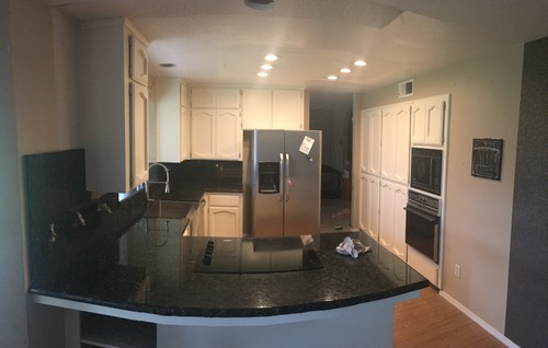Had granite countertops installed and cabinets painted paid