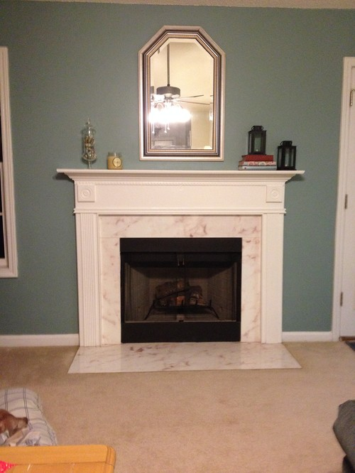 """Home built 2001. Fireplace is prefab one piece. The """"marble"""" around firebox is actually concrete with a faux marble treatment on top. its starting to bubble n peel. I want to demo everything but firebox"""