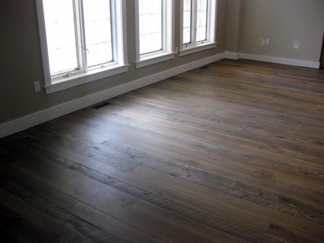 Textured top plank flooring with jacobean grey stain for Hardwood floor dealers